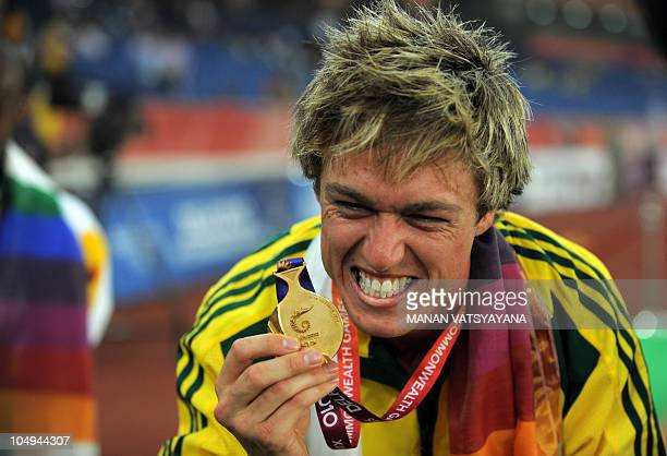 Australia's Simon Patmore celebrates winning gold in the parasport men 100m final of the Track and Field competition of the XIX Commonwealth games on...