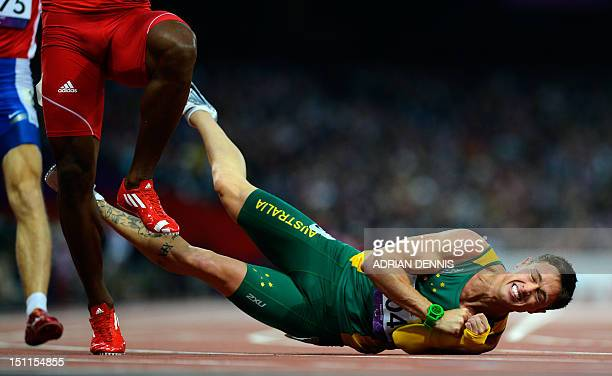 Australia's Simon Patmore falls at the finish line during the Men's 200 metres T46 athletics Final during the London 2012 Paralympic Games at the...