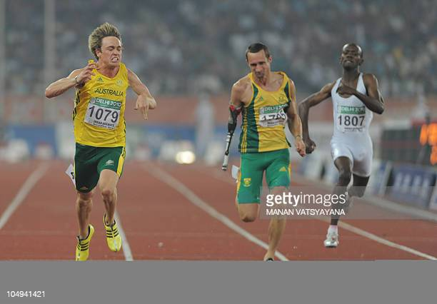 Australia's Simon Patmore wins the parasport men 100m final of the Track and Field competition of the XIX Commonwealth games on October 7 2010 in New...