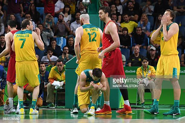 Australia's small forward Joe Ingles, Australia's guard Matthew Dellavedova, Australia's forward Aron Baynes and Australia's forward Ryan Broekhoff...