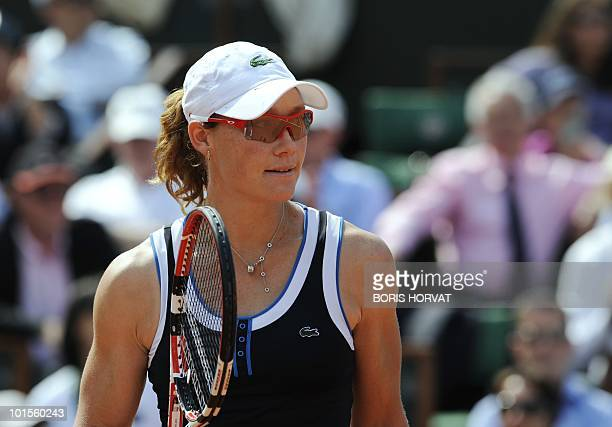 Australia's Smantha Stosur smiles after winning a point during her women's quarter-final against US Serena Williams in the French Open tennis...