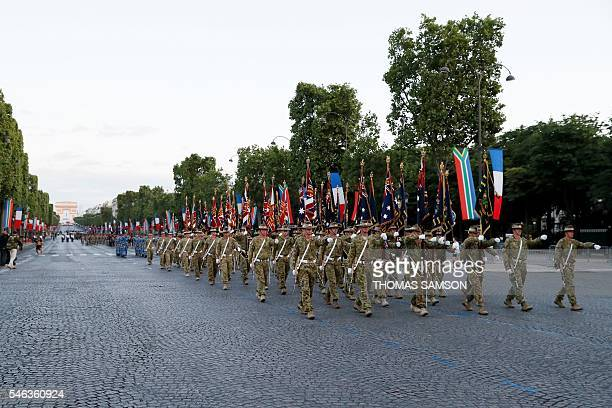 Australia's soldiers attend a rehearsal of the annual Bastille Day military parade on July 12 2016 on the Champs Elysees in Paris / AFP / Thomas...