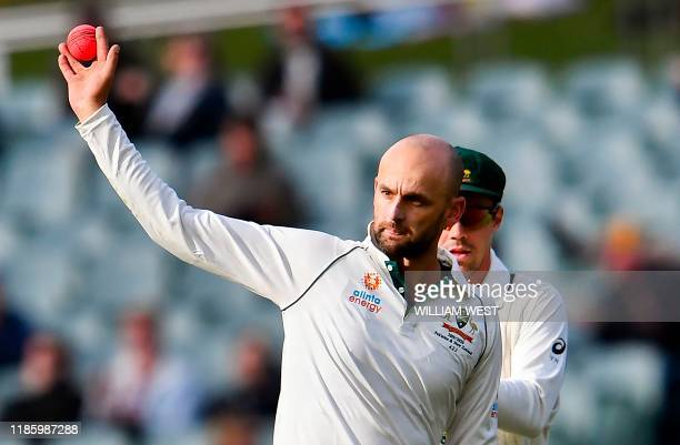 Australia's spinner Nathan Lyon celebrates taking his fifth Pakistan wicket of the innings on the fourth day of the second Test cricket match between...
