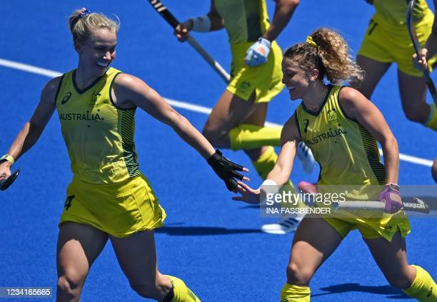 Australia's Stephanie Anna Kershaw and Ambrosia Malone celebrate a team's goal against Spain during their women's pool B match of the Tokyo 2020...