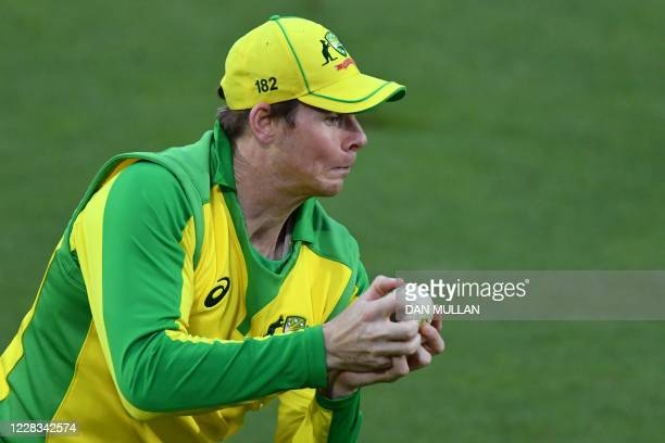 Australia's Steve Smith catches the ball to take the wicket of England's batsman Dawid Malan during the international Twenty20 cricket match between...