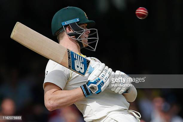 Australia's Steve Smith ducks a high ball after returning to play on the fourth day of the second Ashes cricket Test match between England and...
