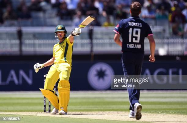 Australia's Steve Smith gestures as England bowler Chris Woakes looks on during their oneday international cricket match played at the MCG in...