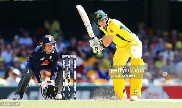 Australia's Steve Smith hits a six as England's Jos Buttler looks on during the 2nd oneday international cricket match between England and Australia...