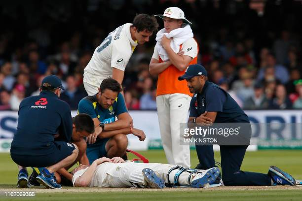 Australia's Steve Smith lays on the pitch after being hit in the head by a ball off the bowling of England's Jofra Archer during play on the fourth...