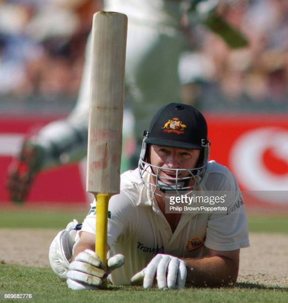 Australia's Steve Waugh acknowledges the crowd by lifting his bat after diving into his ground to complete a century during the 5th Ashes Test match...