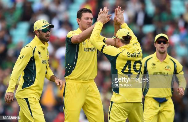 Australia's Steven Smith celebrates with team mates after taking the wicket of Bangladesh's Soumya Sarkar for 3 runs during the ICC Champions trophy...