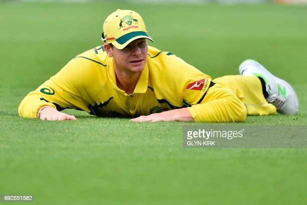 Australia's Steven Smith react after missing a catch during the ICC Champions Trophy match between Australia and Bangladesh at The Oval in London on...