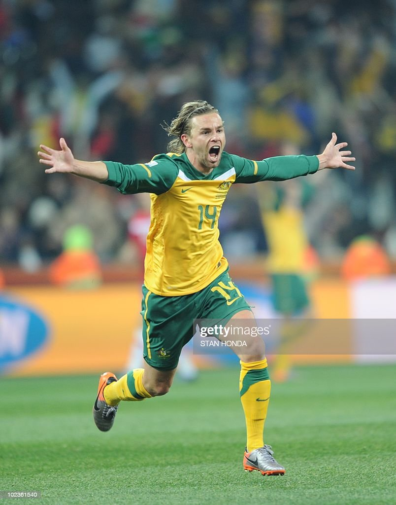 Australia's striker Brett Holman celebrates with teammates after scoring during the Group D first round 2010 World Cup football match Australia vs. Serbia on June 23, 2010 at Mbombela Stadium in Nelspruit. NO