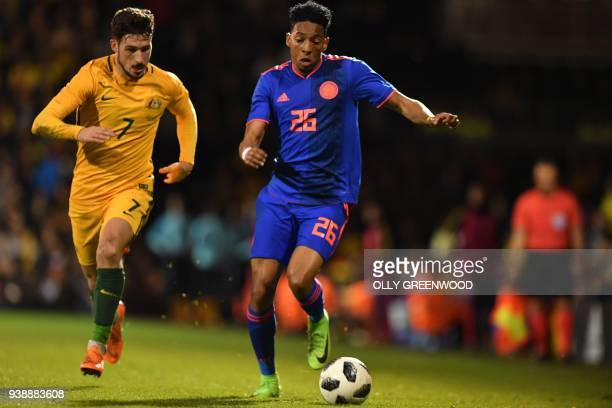 Australia's striker Mathew Leckie vies with Colombia's defender Johan Mojica during the International friendly football match between Australia and...