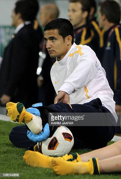Australia's striker Tim Cahill sits with an ice pack on his ankle during the 2011 Asian Cup quarter-final football match between Australia and Iraq...