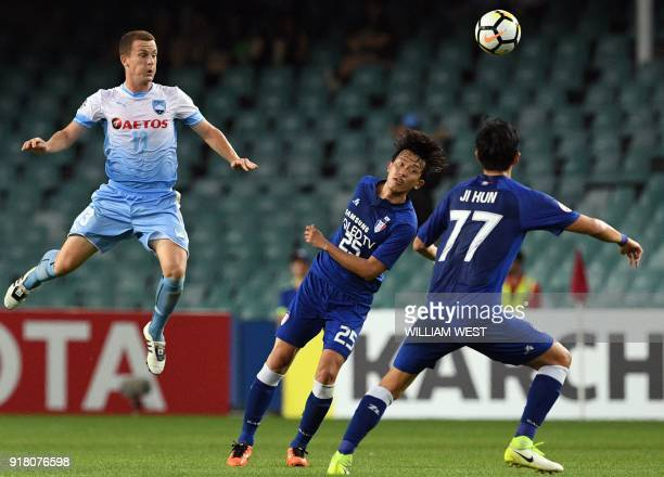 Australia's Sydney FC player Brandon O'Neill heads the ball over South Korea's Suwon Bluewings players during their AFC Champions League football...