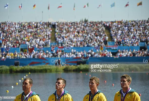 Australia's Tate Smith Dave Smith Murray Stewart and Jacob Clear pose on the podium with their gold medals of the kayak four 1000m men's final A...