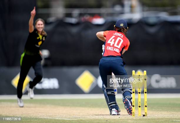 Australia's Tayla Vlaeminck celebrates bowling England's Amy Jones during their women's T20 International cricket match in Melbourne on February 9...