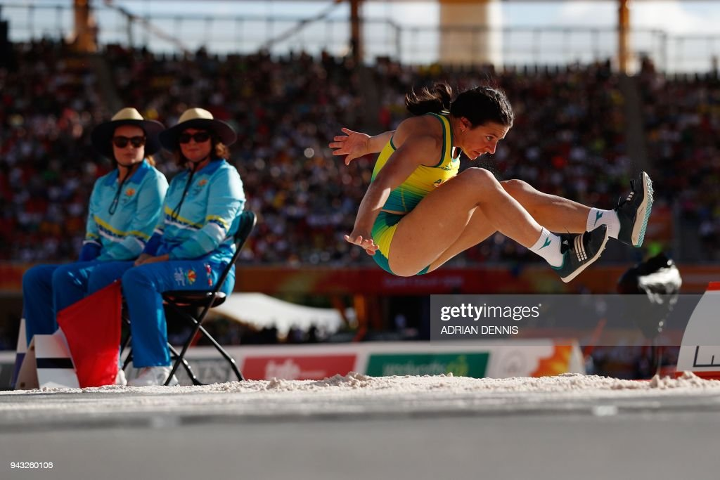 TOPSHOT - Australias Taylor Doyle competes in the athletic's women's T38 long jump final during the 2018 Gold Coast Commonwealth Games at the Carrara Stadium on the Gold Coast on April 8, 2018. / AFP PHOTO / Adrian DENNIS