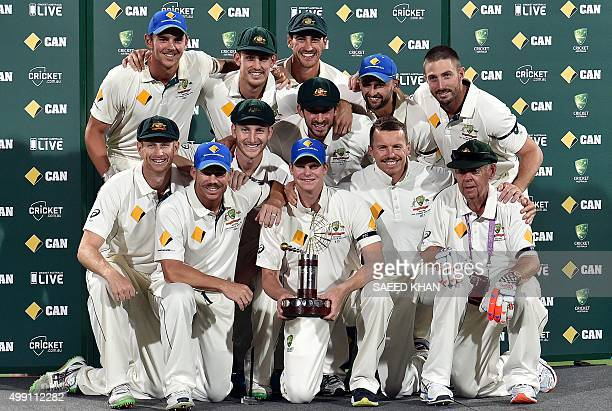 Australia's team captain Steve Smith poses with teammates after defeating New Zealand in the first daynight cricket Test match at the Adelaide Oval...