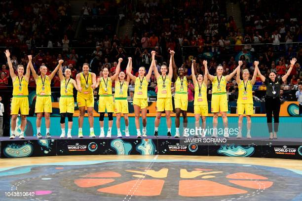 Australia's team celebrates on the podium with their silver medals after the FIBA 2018 Women's Basketball World Cup final match between Australia and...