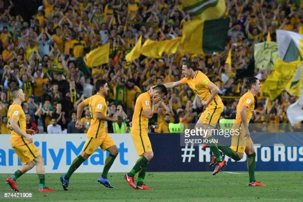 Australia's team celebrates their victory in their World Cup 2018 qualifying football match against Honduras in Sydney on November 15, 2017. / AFP...