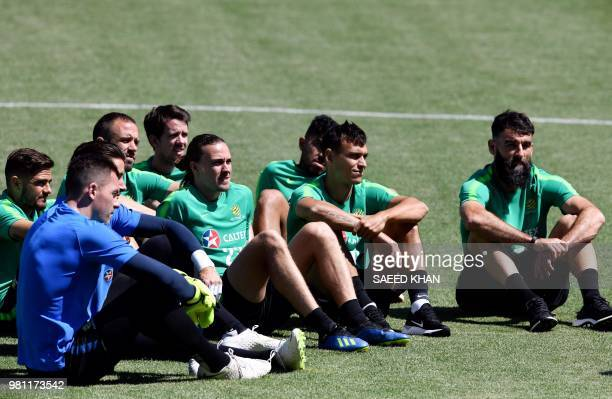 Australia's team players listen to Australia's coach Bert van Marwijk as they take part in a training session of Australia national team in Kazan on...