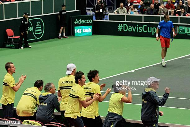 Australia's team react during the first round tennis match between Czech Republic's Lukas Rosol and Australia's Thanasi Kokkinakis of the Davis Cup...
