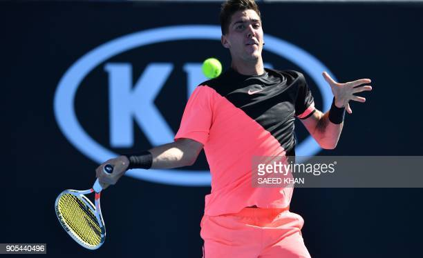 Australia's Thanasi Kokkinakis hits a return against Russia's Daniil Medvedev during their men's singles first round match on day two of the...