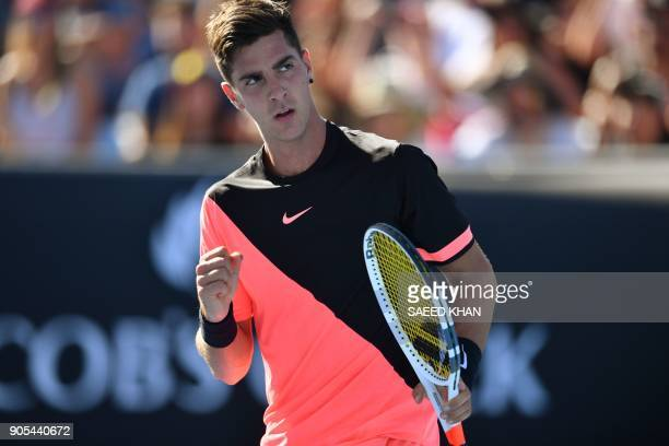 Australia's Thanasi Kokkinakis reacts after a point against Russia's Daniil Medvedev during their men's singles first round match on day two of the...