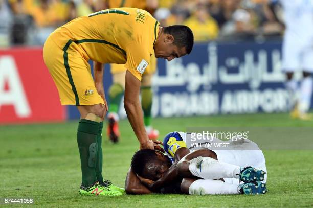 Australia's Tim Cahill attempts to help Honduras' Maynor Figueroa to his feet after Australia defeated Honduras in their 2018 World Cup qualification...