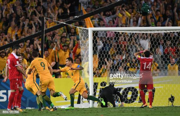Australia's Tim Cahill celebrates his decisive goal against Syria in the second half of the extra time during their 2018 World Cup football...