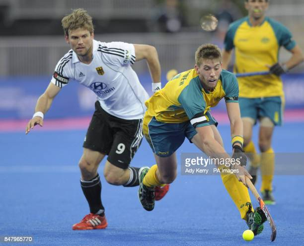 Australia's Tim Ockenden gets away from Germany's Moritz Fuerste during the Visa International Invitational Hockey Tournament at the Riverbank Arena...