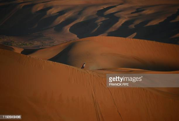Australia's Toby Price powers his KTM motorbike during the Stage 11 of the Dakar 2020 between Shubaytah and Haradh, Saudi Arabia, on January 16, 2020.