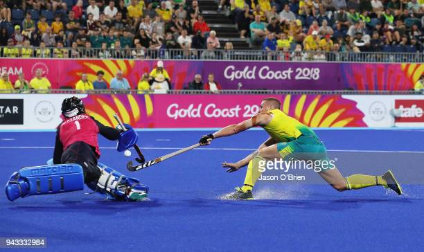 Australia's Tom Wickham shoots at goal against Scotland during Hockey on day four of the Gold Coast 2018 Commonwealth Games at Gold Coast Hockey...