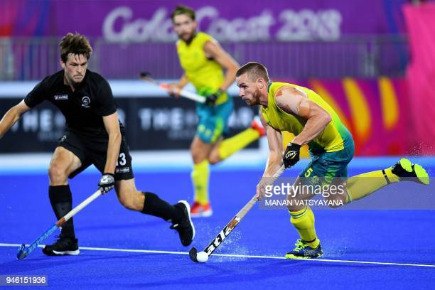 Australia's Tom Wickham vies for the ball with New Zealand's Marcus Child during their men's field hockey gold medal match of the 2018 Gold Coast...
