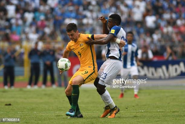 Australia's Tomi Juric and Honduras' Johnny Palacios vie for the ball during the first leg football match of their 2018 World Cup qualifying playoff...