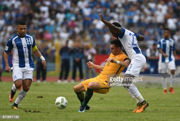 Australia's Tomi Juric is marked by Honduras' Johnny Palacios and Emilio Izaguirre looks on during the first leg football match of their 2018 World...