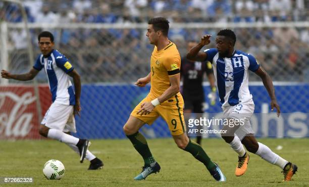 Australia's Tomi Juric is marked by Honduras' Johnny Palacios during the first leg football match of their 2018 World Cup qualifying playoff in San...
