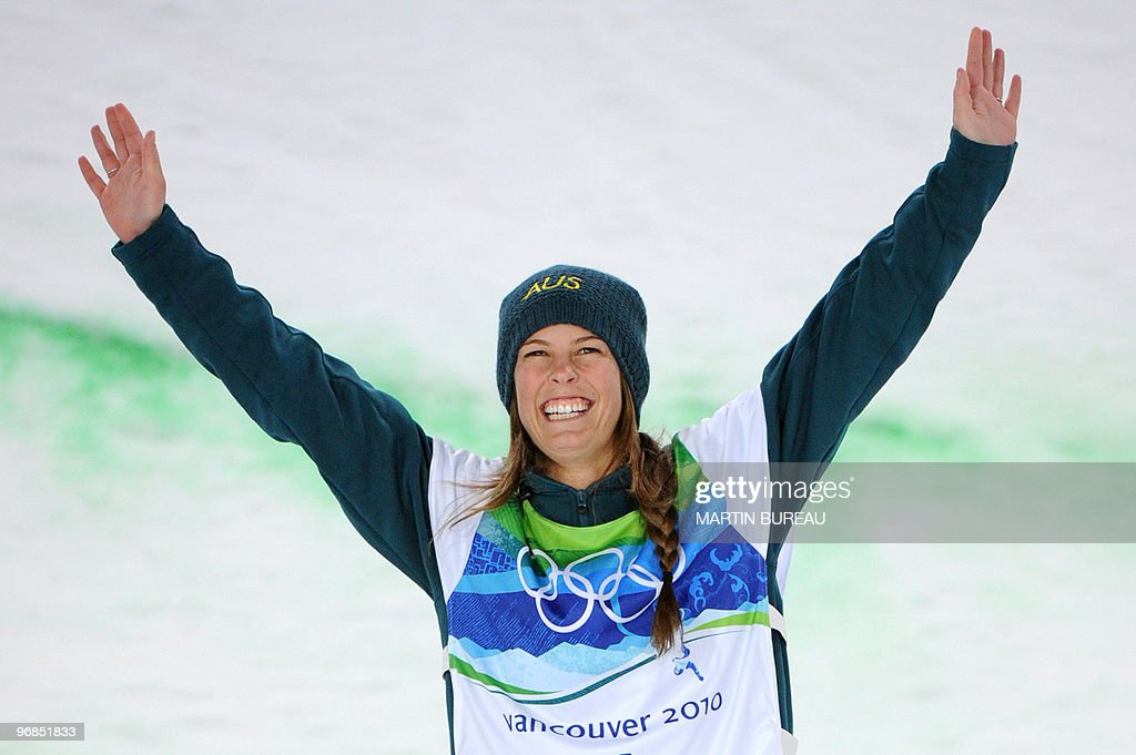 Australia's Torah Bright, gold medalist, celebrates on the podium after the women's Snowboard Halfpipe final at Cypress Mountain, north of Vancouver on February 18, 2010 during the Vancouver Winter Olympics.