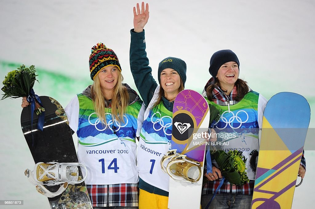 Australia's Torah Bright (C), gold medalist, USA's Kelly Clark (R), bronze and USA's Hannah Teter (L), silver, celebrate on the podium after the women's Snowboard Halfpipe final at Cypress Mountain, north of Vancouver on February 18, 2010 during the Vancouver Winter Olympics.