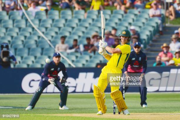 Australia's Travis Head bats during the fourth oneday international cricket match between England and Australia at Adelaide Oval on January 26 2018 /...