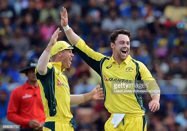 Australia's Travis Head celebrates with teammate David Warner after he dismissed Sri Lanka's Kusal Perera during the fifth and final one day...