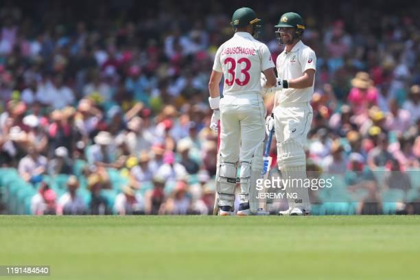 Australias Travis Head congratulates Marnus Labuschagne after reaching 150 runs during the second day of the third cricket Test match between...