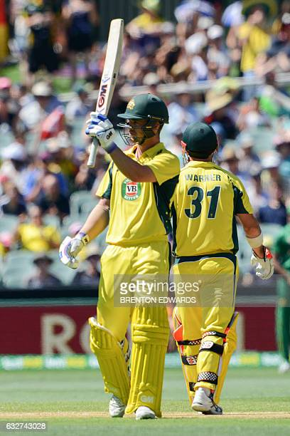 Australia's Travis Head gestures after scoring 50 during the oneday international cricket match between Australia and Pakistan at the Adelaide Oval...
