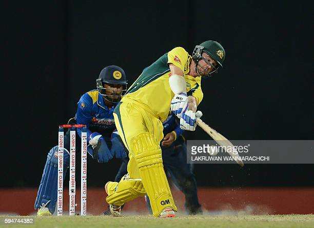 Australia's Travis Head plays a shot as Sri Lanka's wicketkeeper Dinesh Chandimal looks on during the second oneday International cricket match...