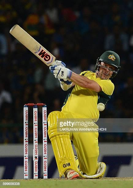 Australia's Travis Head plays a shot during the first T20 international cricket match between Sri Lanka and Australia at the Pallekele International...