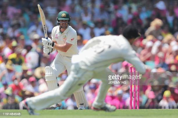 Australias Travis Head plays a shot during the second day of the third cricket Test match between Australia and New Zealand at the Sydney Cricket...