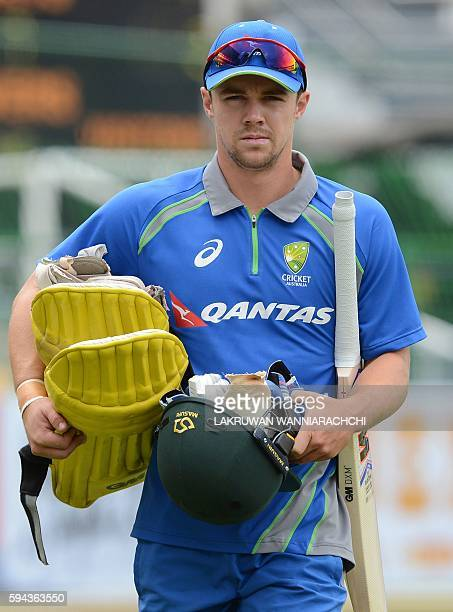 Australia's Travis Head walks with his batting equipment during a training session at The R Premadasa International Cricket Stadium in Colombo on...