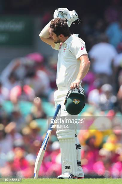 Australias Travis Head wipes sweat as Sydney swelters during the second day of the third cricket Test match between Australia and New Zealand at the...